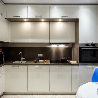 This is an example of a mid-sized contemporary l-shaped separate kitchen in Moscow with a single-bowl sink, flat-panel cabinets, white cabinets, quartz benchtops, brown splashback, stone slab splashback, porcelain floors, no island, beige floor and stainless steel appliances.