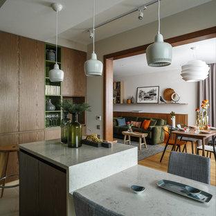 На фото: кухня в современном стиле с островом с