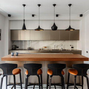 This is an example of a contemporary single-wall kitchen in Moscow with flat-panel cabinets, white splashback, with island, white floor, brown benchtop, a double-bowl sink, grey cabinets, wood benchtops, marble splashback and marble floors.
