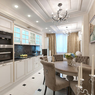Mid-sized traditional single-wall eat-in kitchen in Saint Petersburg with an integrated sink, raised-panel cabinets, white cabinets, quartz benchtops, brown splashback, travertine splashback, stainless steel appliances, porcelain floors, no island, white floor and grey benchtop.