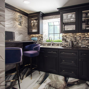 This is an example of a small contemporary kitchen in London with a double-bowl sink, black cabinets, black splashback, beaded inset cabinets, wood benchtops, ceramic splashback and ceramic floors.