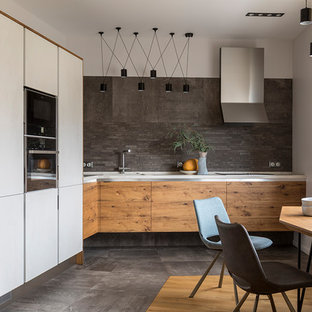 Mid-sized contemporary eat-in kitchen designs - Inspiration for a mid-sized contemporary l-shaped gray floor eat-in kitchen remodel in Moscow with an undermount sink, flat-panel cabinets, medium tone wood cabinets, gray backsplash, black appliances and no island