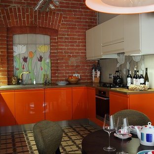 Industrial kitchen designs - Inspiration for an industrial kitchen remodel in Moscow with orange cabinets