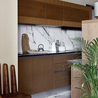 На фото: маленькая параллельная кухня-гостиная в современном стиле с плоскими фасадами, фасадами цвета дерева среднего тона, столешницей из кварцевого агломерата, белым фартуком, фартуком из керамогранитной плитки, полом из керамогранита, островом и белым полом