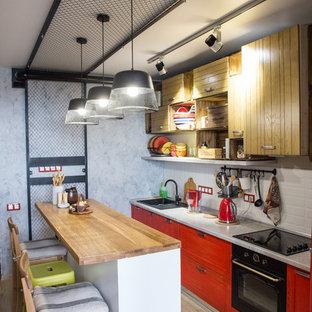 Imagen de cocina lineal, industrial, con península