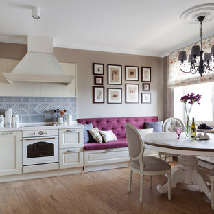 Design ideas for a large midcentury l-shaped eat-in kitchen in Other with raised-panel cabinets, beige cabinets, solid surface benchtops, grey splashback, ceramic splashback, white appliances, ceramic floors and no island.