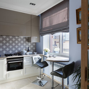 Inspiration for a contemporary kitchen in Saint Petersburg with grey splashback and black appliances.