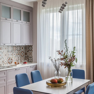 Design ideas for a transitional eat-in kitchen in Moscow with purple cabinets, multi-coloured splashback, medium hardwood floors and white benchtop.