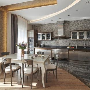 На фото: прямая кухня в современном стиле с обеденным столом, плоскими фасадами, фасадами из нержавеющей стали, серым фартуком, фартуком из плитки мозаики, черным полом, черной столешницей и мраморным полом без острова