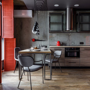 Design ideas for a mid-sized contemporary l-shaped kitchen in Other with an undermount sink, open cabinets, laminate benchtops, grey splashback, glass tile splashback, black appliances, porcelain floors, beige floor and beige benchtop.