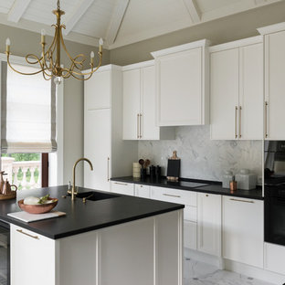 Transitional Galley Kitchen In Moscow With White Cabinets, White  Splashback, Black Appliances, Marble