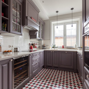 Design ideas for a large transitional u-shaped separate kitchen in Moscow with an undermount sink, recessed-panel cabinets, grey cabinets, solid surface benchtops, white splashback, ceramic splashback, ceramic floors, no island, red floor and white benchtop.