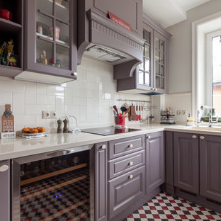 Inspiration for a large transitional kitchen in Moscow with an undermount sink, solid surface benchtops, white splashback, porcelain splashback, stainless steel appliances, ceramic floors, no island, white benchtop, raised-panel cabinets, purple cabinets and multi-coloured floor.