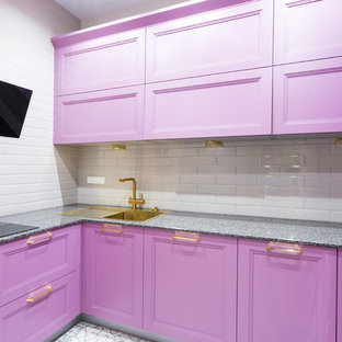 This is an example of a small contemporary u-shaped separate kitchen in Moscow with recessed-panel cabinets, purple cabinets, granite benchtops, white splashback, subway tile splashback, black appliances, no island, grey floor and a drop-in sink.