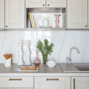 Inspiration for a small transitional single-wall eat-in kitchen in Other with a drop-in sink, recessed-panel cabinets, green cabinets, laminate benchtops, white splashback, porcelain splashback, laminate floors, beige floor and beige benchtop.