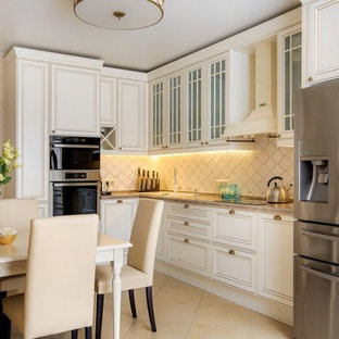 Photo of a mid-sized transitional l-shaped separate kitchen in Yekaterinburg with beige splashback, ceramic splashback, stainless steel appliances, porcelain floors, beige floor, a drop-in sink, white cabinets and no island.