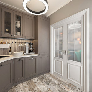 This is an example of a mid-sized industrial l-shaped separate kitchen in Moscow with an undermount sink, medium wood cabinets, marble benchtops, metal splashback, black appliances, porcelain floors, no island, white benchtop, raised-panel cabinets, metallic splashback and multi-coloured floor.
