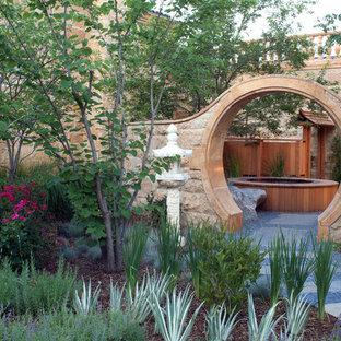 Photo of an asian partial sun courtyard stone garden path in Denver.