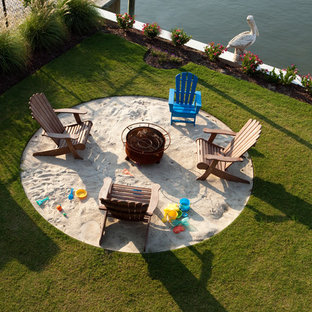 Inspiration for a contemporary landscaping in Wilmington with a fire pit.