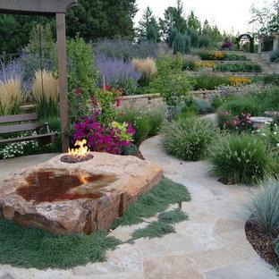 Design ideas for a mediterranean backyard garden in Denver with a fire feature.