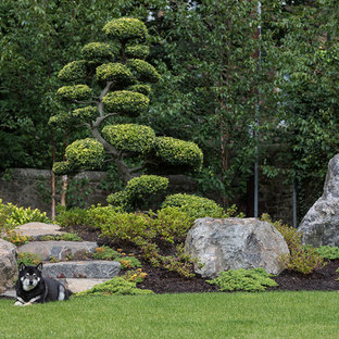 Large asian backyard partial sun formal garden in Boston with a garden path and natural stone pavers.