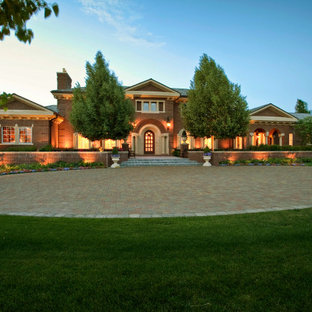 This is an example of a traditional front yard brick driveway in Denver for summer.