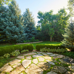 This is an example of a traditional backyard stone formal garden in Denver for summer.