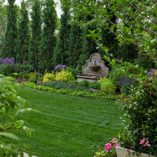 Inspiration for a craftsman backyard stone formal garden for summer.