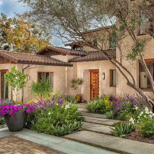 This is an example of a mediterranean front yard flower bed in Orange County.