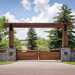 This is an example of a farmhouse privacy and full sun front yard driveway in Denver for summer.