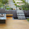 Outdoor Rooms and Stylish Plantings Tame a Hilly Lot