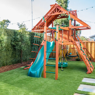Inspiration for a transitional backyard wood fence outdoor playset in Richmond.