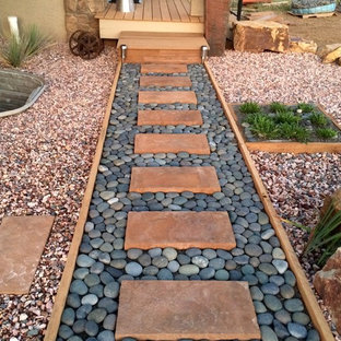Design ideas for a mid-sized southwestern drought-tolerant and full sun backyard gravel garden path in Other for summer.
