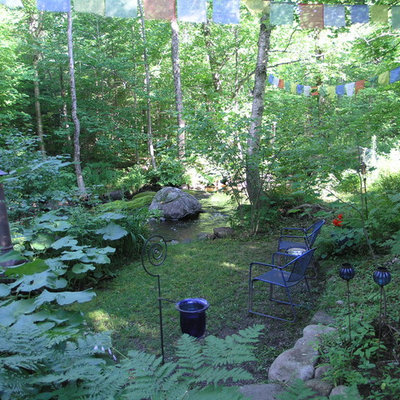Inspiration for an eclectic shade backyard landscaping in Burlington.