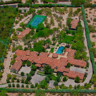 Photo of a mediterranean full sun rooftop landscaping in Phoenix.