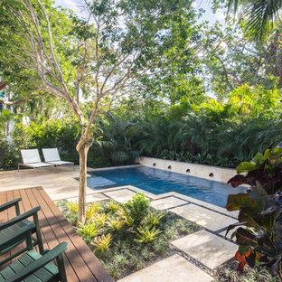 Inspiration pour un jardin à la française arrière marin de taille moyenne avec une exposition ensoleillée et des pavés en pierre naturelle.