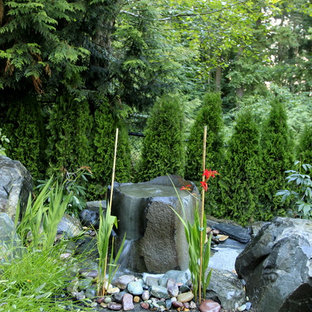 This is an example of a traditional backyard water fountain landscape in Seattle.