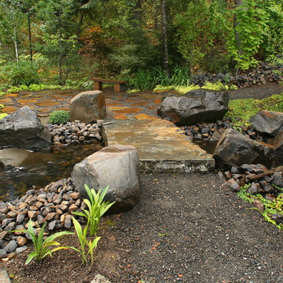 Inspiration for a traditional backyard gravel water fountain landscape in Seattle.