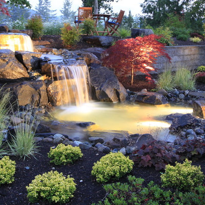 This is an example of a traditional backyard river rock waterfall in Seattle.