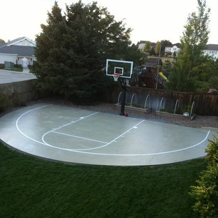 Photo of a huge traditional partial sun backyard outdoor sport court in Denver.