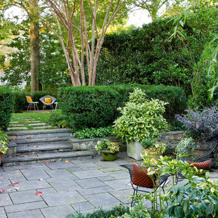 This is an example of a mid-sized traditional backyard stone landscaping in DC Metro.