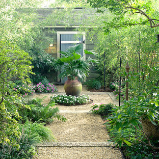 Traditional courtyard formal garden in DC Metro with gravel.