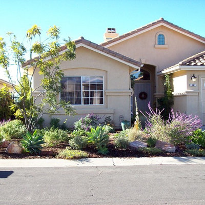 Inspiration for a mid-sized traditional partial sun front yard concrete paver driveway in San Diego.