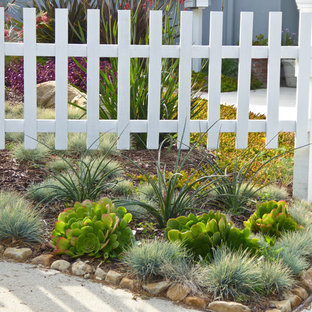 Photo of a small eclectic drought-tolerant and full sun front yard stone garden path in Santa Barbara.