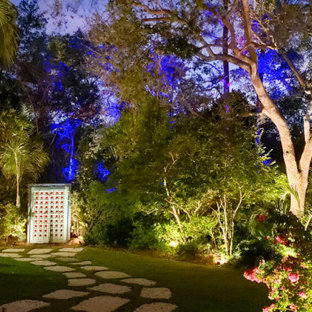 Photo of a large tropical drought-tolerant and partial sun backyard stone garden path in Miami.