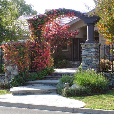 Photo of a mid-sized traditional partial sun front yard stone landscaping in San Francisco for fall.