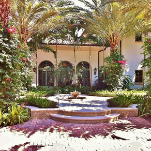 This is an example of a mediterranean courtyard landscaping in Miami.