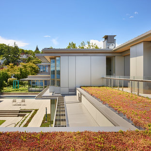 Design ideas for a contemporary full sun rooftop formal garden in Seattle with decking.