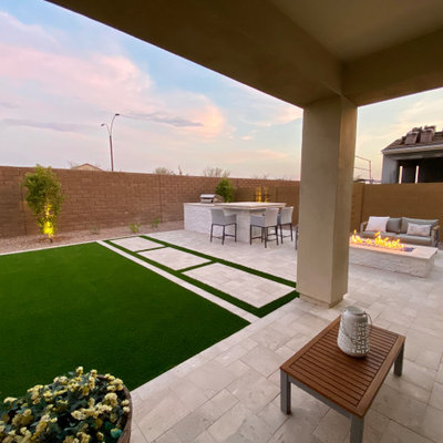 Inspiration for a large contemporary full sun backyard stone and stone fence landscaping in Phoenix.