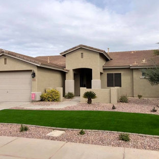 This is an example of a large contemporary full sun front yard stone and stone fence landscaping in Phoenix.